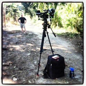 ThinkTank's backpack sits at the feet of Movies by Depuhl's camera setup for an interview in the jungle.