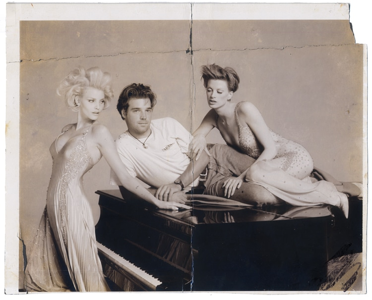 Pascal Depuhl lies on a grand piano standing in on a Versache photoshoot by Richard Avedeon with Nadja Auerman and Pascal Depuhl assisted Richard Avedon in the 90's. This polaroid was given to him by Mr. Avedon after being a stand in on a Versache campaign with Nadja Auerman and Kirsten McMenemy.