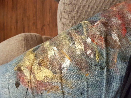 Brightly coloured paint covered jeans