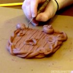 sculpting a fairy door in wax/clay