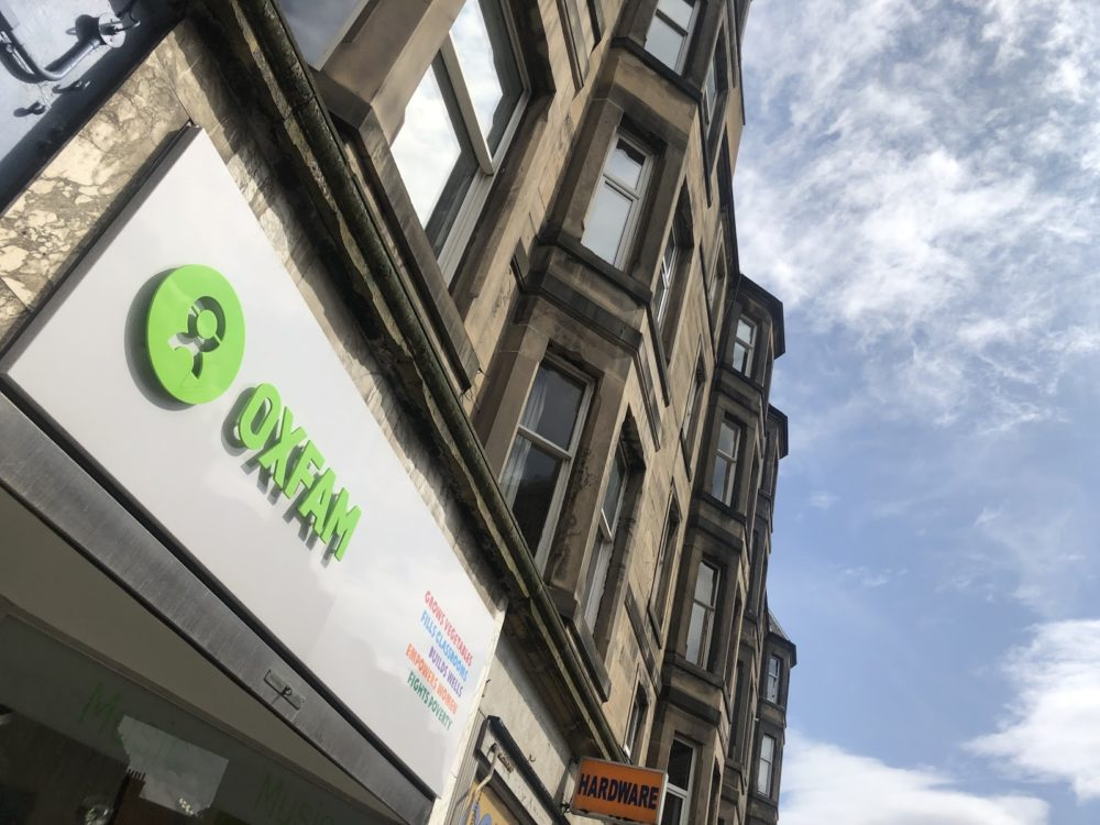Exterior sign of Oxfam Music record shop in Endinburgh, Scotland