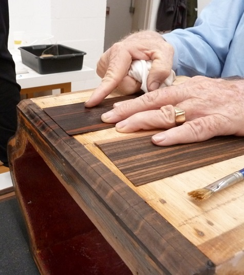 Collaboration between curator and conservators – a discussion on original wooden base height, veneer, and finish