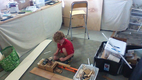 Liam, Lesli's son, playing in her studio