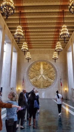 The Great Hall inside the Hall of State, with the gold medallion representing the six nations