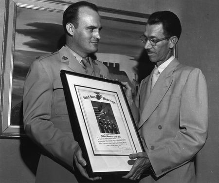 Certificate of appreciation for the museum's wartime support from the United Stated Marine Corps, presented to Jerry Bywaters.