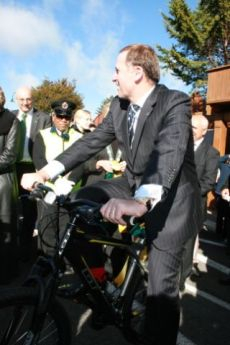 Prime Minister John Key on the signed bike which was raffled