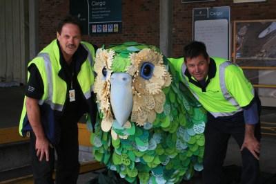The team at Air New Zealand pose with Kiri te Kākāpō.