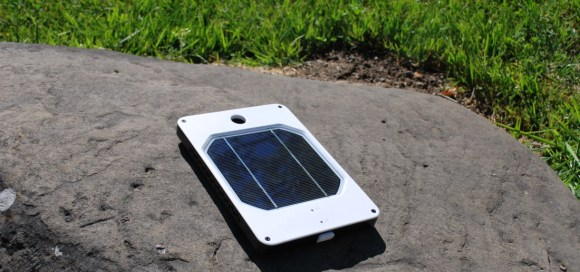 A portable solar charger in the sun.