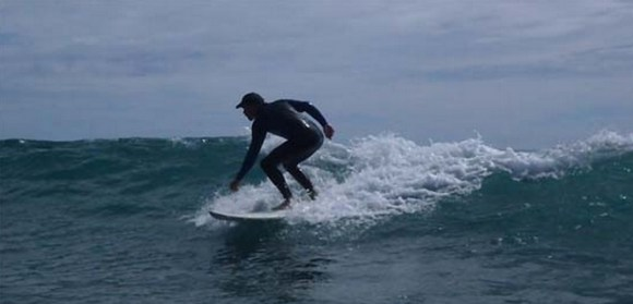 Andy going for a surf.