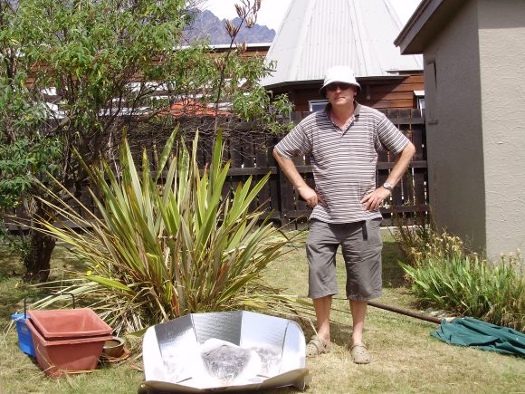 Herb using a solar cooker in Central Otago.