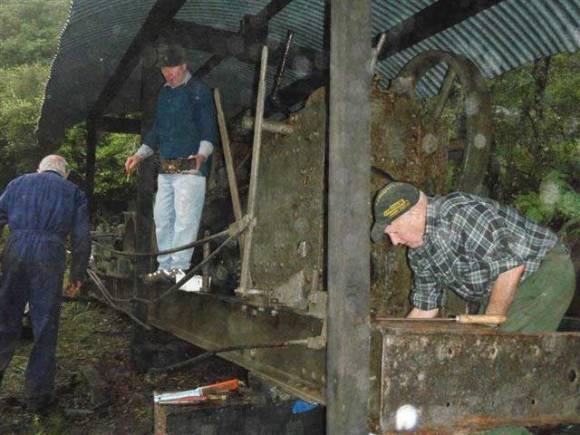 All three Vintage Machinery  Club members working hard.