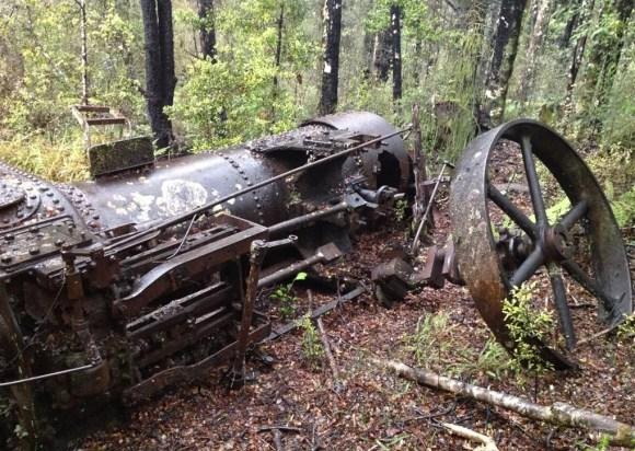 Marshall portable steam engine half buried.