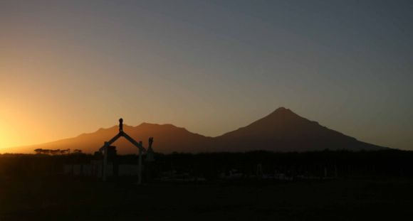 Mount Taranaki in the background at dusk.