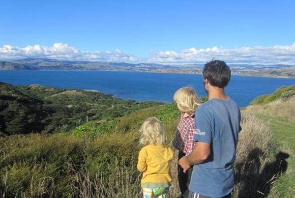 Jeff and his children on Mana Island.