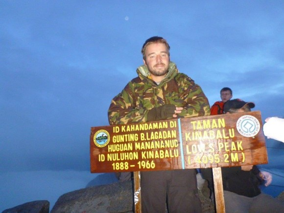 Dan Lee at the summit of Mount Kinabalu.