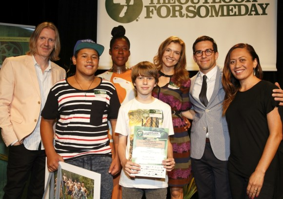 Upokongaro Film-making Club accept their award from Outlook Ambassadors Tandi Wright and Jared Turner.