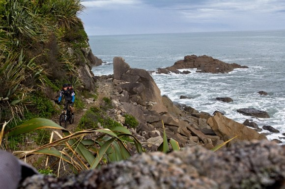 Riding along the coast on the Heaphy Track. Photo: Jono/Squid faced boy.