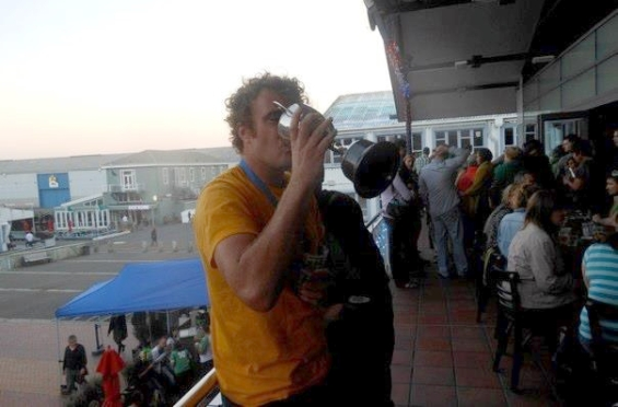 James drinking from the cup after winning the Wellington Dragon Boat Festival.