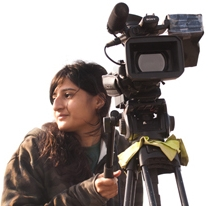 Ashwika Kapur holding a video camera.