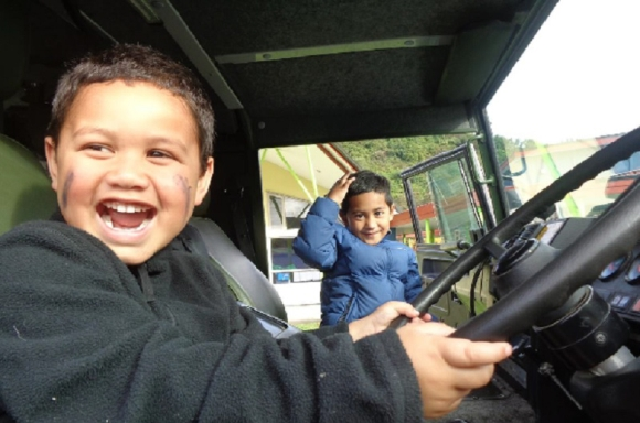 Children sitting in the Pinzgauer six-wheeler truck.