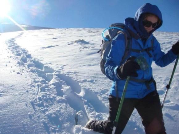 Susie walking through snow in the Crown Range.