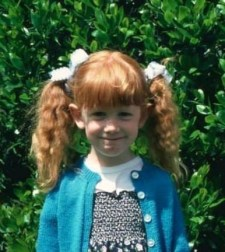 Susie as a young girl with ginger hair.