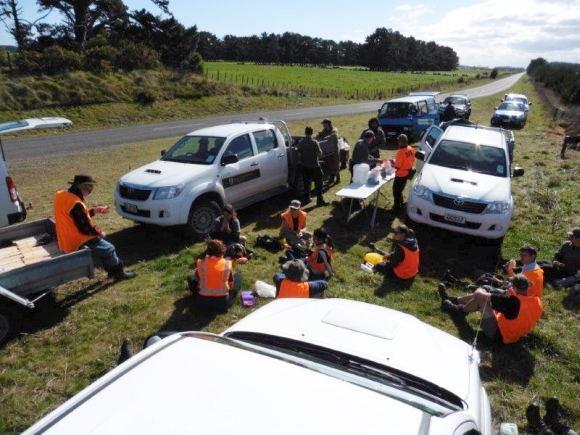 Volunteers back at their vehicles for a lunch break.