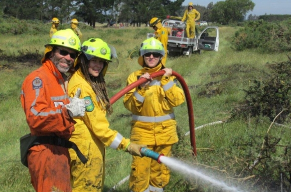Emma holding a fire hose during training.