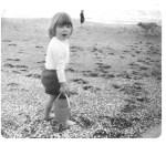 Elizabeth as a child at the beach.