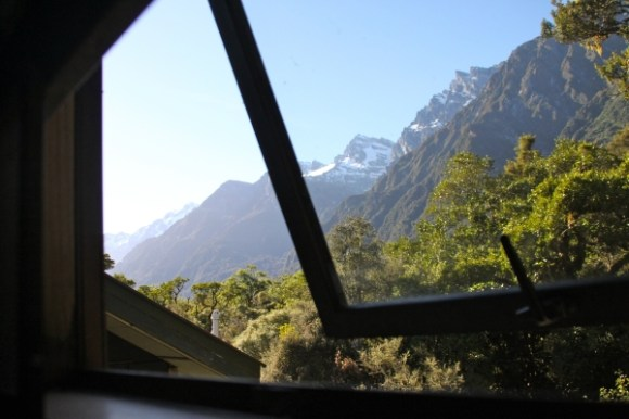 View of mountains and forest from the window of Welcome Flat Hut. Photo: Nate/Nghikr | CC BY-NC-SA 2.0.