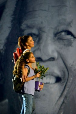 Opening ceremony: Young woman and girl holding a potted plant. Photo: IUCN World Parks Congress Facebook.
