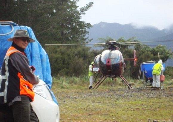 Greg preparing for an aerial bait drop.