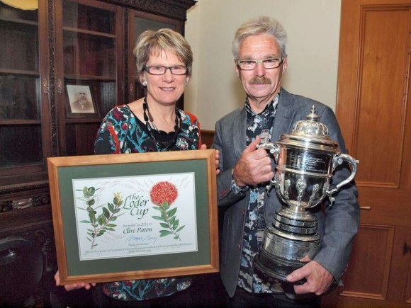 Clive Paton with his wife, Phyll, displaying the Loder cup and certificate.