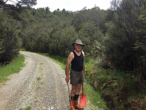 Jim clearing drains on the Prohibition Road, Waiuta. Photo: Gav Collis.