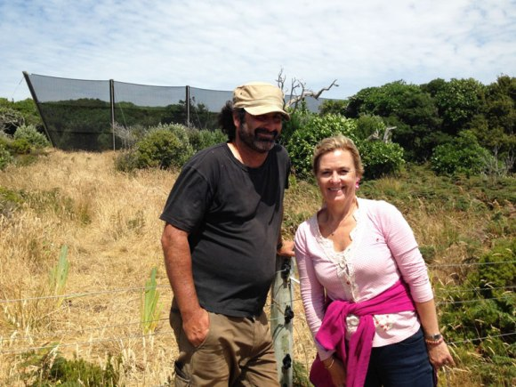 Justin Maxwell and Susan Thorpe pose in front of new wind fence.