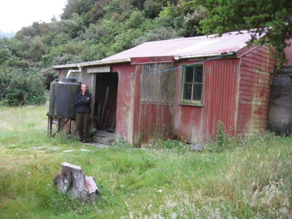 Terry standing in front of the old Dillons homestead in the Taipo Valley.