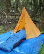 Heather Morison's colleague sleeping in a child's tent.