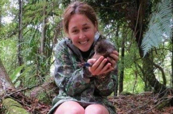 Emma Erickson holds a kiwi at Te Urewera Mainland Island.