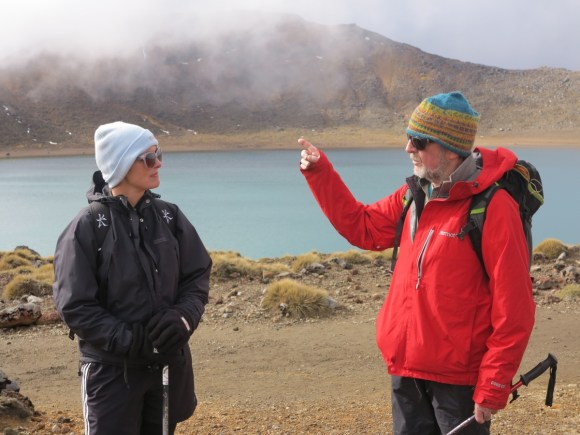 Guide Harry Keys explaining features of the Tongariro Crossing in front of Blue Lake.