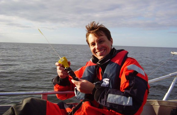 Andrew on a boat, recovering bioacoustic data from harbour porpoises in Denmark.