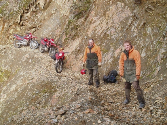Rangers clearing a rockfall along a well-known clip on Old Ghost Road.