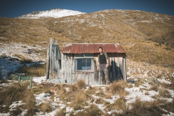 Will McBeth outside Home Hill Hut, above the Caples Valley.