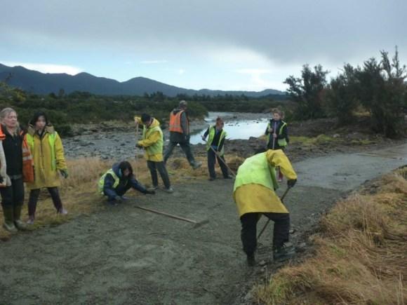 Conservation Volunteers New Zealand volunteers raking the new track.