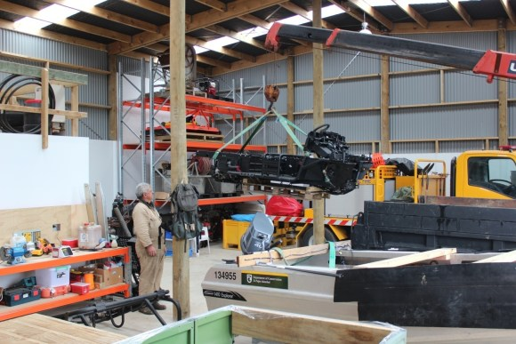 Brownie Walker supervising the weighing of the Mule frame and engine.