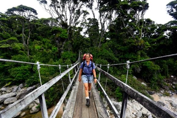 Anja crossing a bridge on the Heaphy Track.
