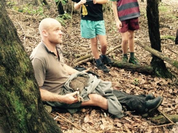 James McLaughlin holding a kiwi.