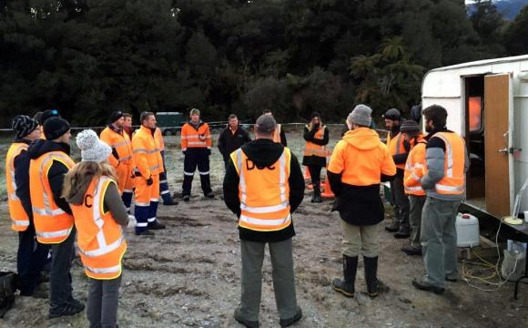 DOC staff and contractors attend a safety briefing on-site at the Haast/Arawhata pre-feed operations on Tuesday.