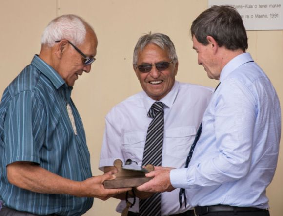 Kaumātua Bevan Taylor, Kaumātua Tamehana Manaena, and DOC Deputy Director-General Operations Mike Slater with the mere pounamu gifted from DOC to Maungaharuru-Tangitū. Photo: Lauren Buchholz