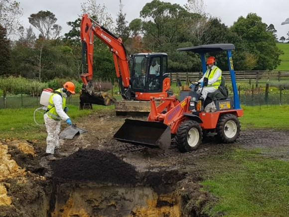 MPI biosecurity staff bury potting mix in Kerikeri nursery.