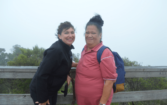 Smiles from walkers at the summit of Rangitoto Island.
